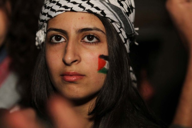 A woman with a Palestinian flag painted on her cheek celebrates on new year's eve in the West Bank city of Ramallah on December 31, 2012. (Abbas Momani/AFP/Getty Images)