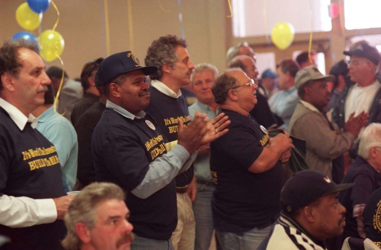 OCTOBER 21, 1997: James Bannister, vice-president of United Steelworkers local 2610, center, applauds during a rally at the United Steelworkers Union. The rally was held to demand that Bethlehem Steel make the investment at Sparrows Point of a new cold-rolling mill, otherwise 500 jobs could be lost. (Nanine Hartzenbusch/Baltimore Sun)