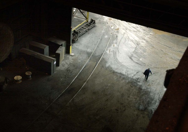 APRIL 9, 2003: A lone employee enters the massive doorway to the L Furnace at Bethlehem Steel at Sparrows Point. In better days in the late 1950s, Sparrows Point's mill and shipyards throughout Baltimore's waterfront, had more than 45,000 employees. (Algerina Perna/Baltimore Sun)
