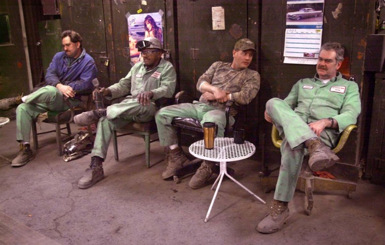 APRIL 24, 2003: In the break room in the basic oxygen furnace building, At Bethlehem Steel, millwrights wait to put the furnace back on line. Left to right: Mike Bochenick, 39, (w/ co. for 7 yrs.); crew leader Howard Wilmer, 60 (w/ co. for 39 years); Don Webster, 34 (w/ co. for 6 1/2 years); and Fred Mathews, 52, (w/ co. for 7 yrs). (Algerina Perna/Baltimore Sun)