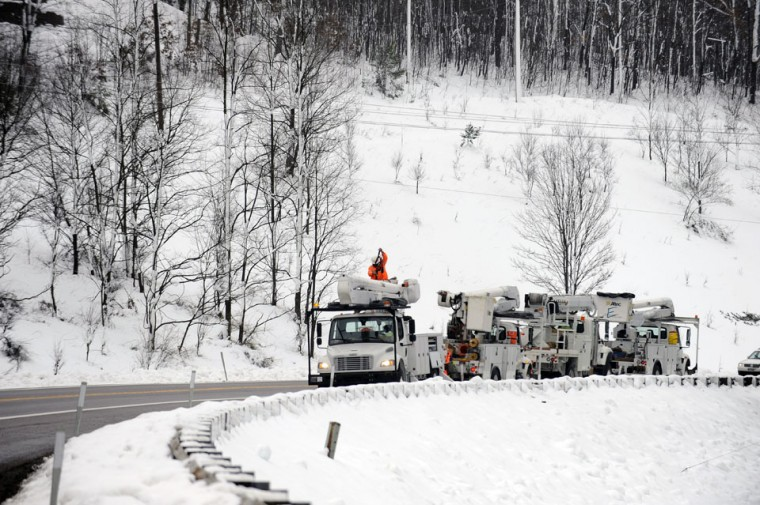 Nov. 2: Sandy snow in Garrett Co.: Utility crews working to restore power lines near Deep Creek Lake in Western Maryland. Garrett County is trying to recover after Superstorm Sandy dumped over two feet of snow in the county causing wide spread power outage. (Kenneth K. Lam/Baltimore Sun)