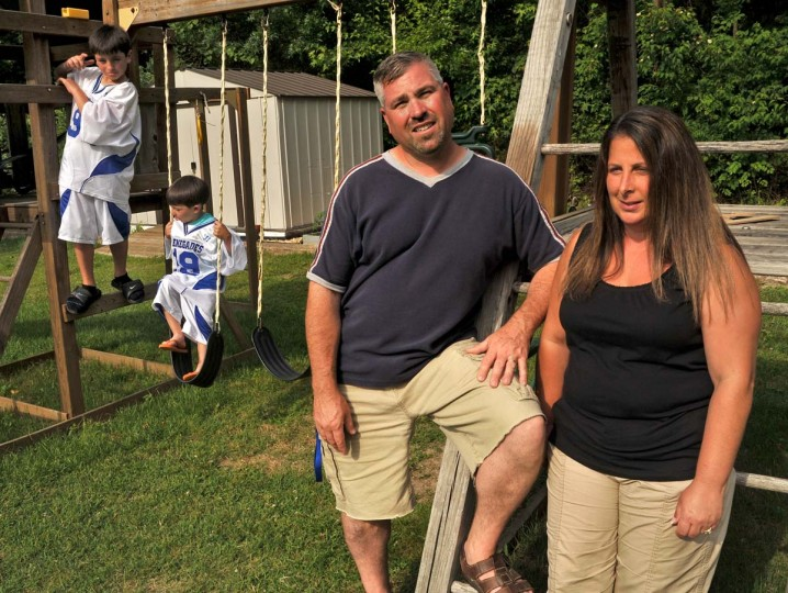 JUNE 7, 2012: Rodney Donald with wife Tina, and their sons, Aaron, 8, far left, and Zack, 5, at their home. Donald, 40, a maintenance technician at Sparrows Point for 16 years, is one of the workers facing layoffs while the owners of the bankrupt steel mill look for a buyer. (Amy Davis/Baltimore Sun)