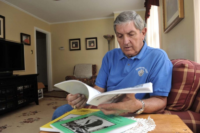"AUGUST 10, 2012: Elmer Hall looks through ""Diary of a Mill Town: Recollections of the Bungalows and Sparrows Point,"" one of three books he has written on the mill area. Hall grew up in the Sparrow Point mill's company town. The town was demolished in 1972 to make way for the ""L"" blast furnace. He worked at the mill for five years and in recent years he's been writing books about the its history. (Kim Hairston/Baltimore Sun)"