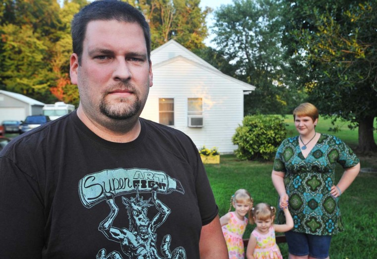 AUGUST 16, 2012: Shown is Forrest Martin with his wife Lacey and their two daughters, 4-year-old Ophelia and 2-year-old Alice. Many of Sparrows Point's workforce have labored there for three decades or more. Forrest Martin, 31, has been at the steel mill since 2008. He's an example of the younger crowd, the ones for whom retirement is not an option. (Gene Sweeney Jr./Baltimore Sun)