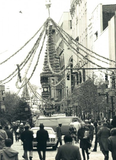 The countryside has lost the leaves of summer and its beauty is now the stark and wintry kind, with bare trees seen silhouetted against the cold sky, but downtown Baltimore has sprouted its own seasonal foliage — Christmas tinsel and lights — as here in Lexington Market. Dec. 7, 1977. (Carl D. Harris/Baltimore Sun)