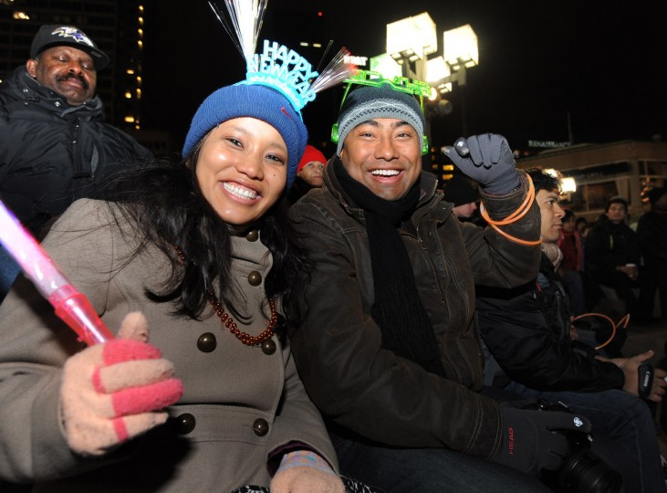 Puja Sthapit, (c) 28, left, and Anit Lacoul, 29, from Ellicott City listen to the band, Outbreak, at the Inner Harbor as part of the New Year festivities. (Algerina Perna/Baltimore Sun)