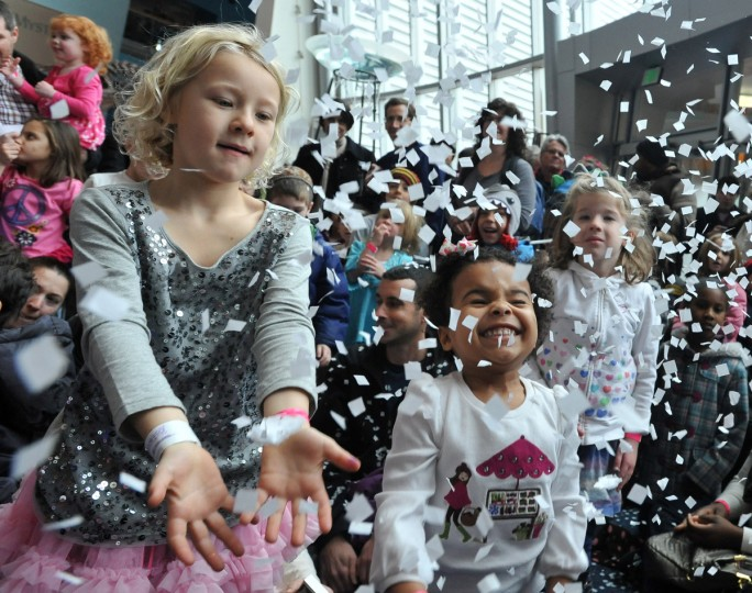 Charlotte Marshall, left, and Stella Rose Dorazio ring in 2013 early at the Maryland Science Center's noon New Year's Eve celebration with the band Milkshake and a ball drop with confetti. (Amy Davis/ Baltimore Sun)