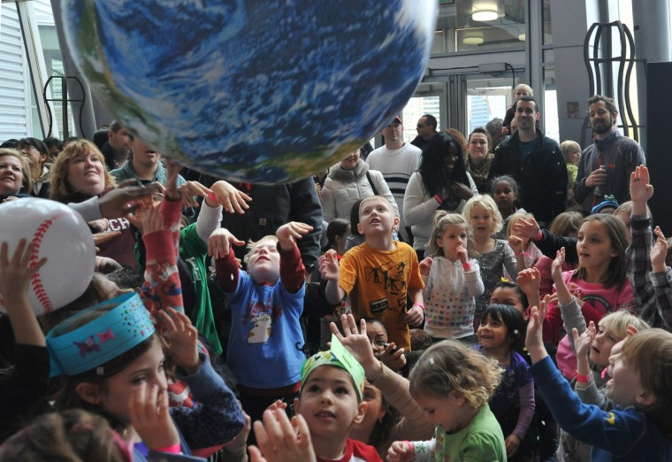 Children ring in 2013 early at the Maryland Science Center's noon New Year's Eve celebration