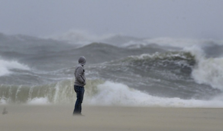 Oct. 29: Sandy approaches: Standing on the beach overlooking the Atlantic Ocean as sand blows at his feet, Charles McAleer of Berlin, MD watches the impact of the storm effects from Hurricane Sandy, which has yet to arrive in the region Sunday, Oct 28, 2012. Hurricane Sandy, still hundreds of miles from Ocean City, has yet to actually impact the mid-Atlantic states. (Karl Merton Ferron/Baltimore Sun)