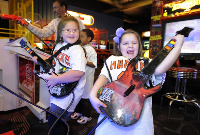 Dec. 12: Party down: Ava Latham and Kassidy Leeson (right) play Guitar Hero together at the OriolesREACH holiday party. Current and former Orioles hosted students from Morrell Park Elementary Middle School in Baltimore as part of the 34th Annual OriolesREACH Holiday Party for Kids at Dave & Busters in the Arundel Mills Mall. (Lloyd Fox/Baltimore Sun)