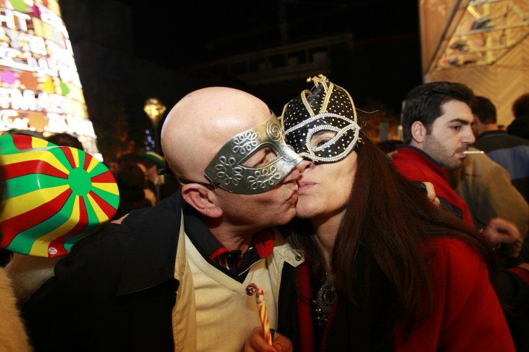 Lebanese people kiss as they celebrate on new year's eve in Beirut, early on January 1, 2013. (Anwar Amro/Getty Images)