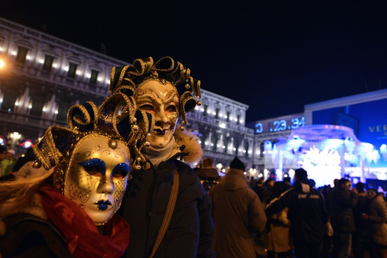 People celebrate the New Year at the Piazza San Marco in Venice, early on January 1, 2013. (Andrea Pattaro/Getty Images)