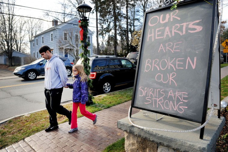 A sign speaks to the grief felt by residents from Newtown, Connecticut, a day after a shooting at Sandy Hook Elementary School where at least 26 people were killed. (Olivier Douliery/Abaca Press/MCT Photo)