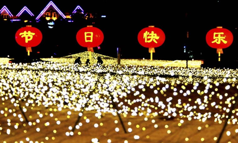 The lighting scenery is pictured at the People Square in Dalian, northeast China's Liaoning Province. The lights were lit to celebrate the coming of New Year. (Lv Wenzheng/Xinhua/Zuma Press/MCT)