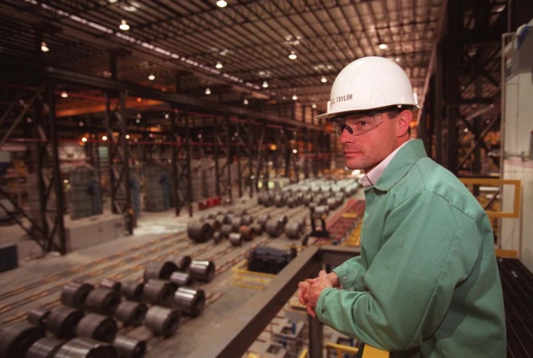 MAY 1, 2000: Bethlehem Steel's new cold steel mill. Manufacturing Manager Steve Taylor stands on a platform overlooking coils of steel. (Barbara Haddock Taylor/Baltimore Sun)