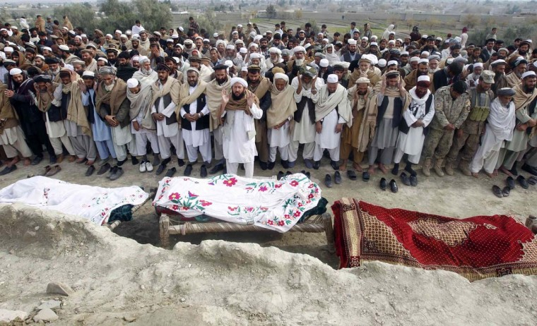 Afghan villagers pray over the bodies of girls who were killed by an explosion in Jalalabad December 17, 2012. A blast killed 10 Afghan girls, between nine and 11 years old, as they were collecting firewood in eastern Afghanistan on Monday, government officials said. (Parwiz/Reuters)
