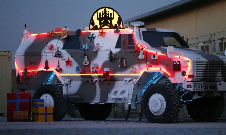 A German Bundeswehr army Dingo armored vehicle, which is decorated as an Advent calendar, is illuminated with Christmas lights in an army camp in Kunduz, northern Afghanistan, on December 3, 2012. (Fabrizio Bensch/Reuters)