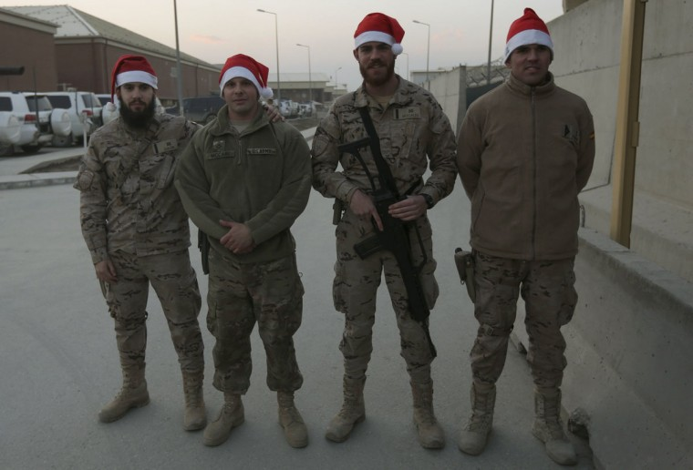 Spanish and U.S. soldiers with the NATO-led International Security Assistance Force (ISAF), wearing Santa hats, pose for a photograph during Christmas Eve celebrations at a NATO camp in Kabul on December 24, 2012. (Omar Sobhani/Reuters)