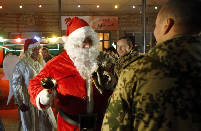 German Bundeswehr armed forces soldiers dressed as Santa Claus and angels arrive to a Christmas market at camp Marmal near Mazar-e-Sharif, northern Afghanistan on December 16, 2012. (Fabrizio Bensch/Reuters)