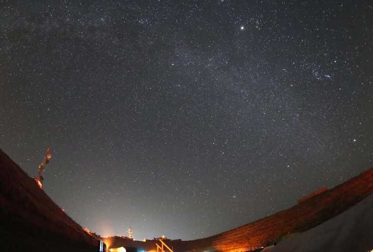 The stars are pictured in this long exposure photograph, in the sky over the German Bundeswehr army combat outpost OP North, near Baghlan, northern Afghanistan, December 9, 2012. (Fabrizio Bensch/Reuters)