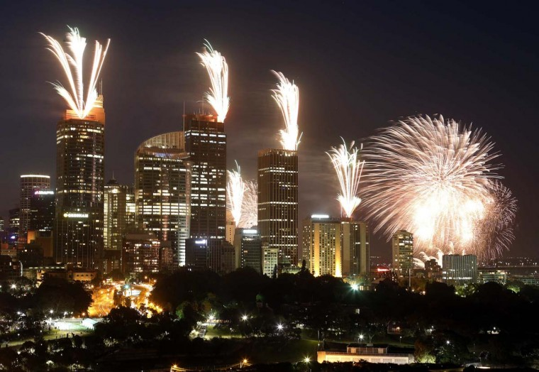 Fireworks explode on the rooftops of buildings in the city during a show prior to the new year celebrations in Sydney December 31, 2012. More than 1.5 million people were expected to line the foreshores of the harbour to watch the annual fireworks show. (David Gray/Reuters)