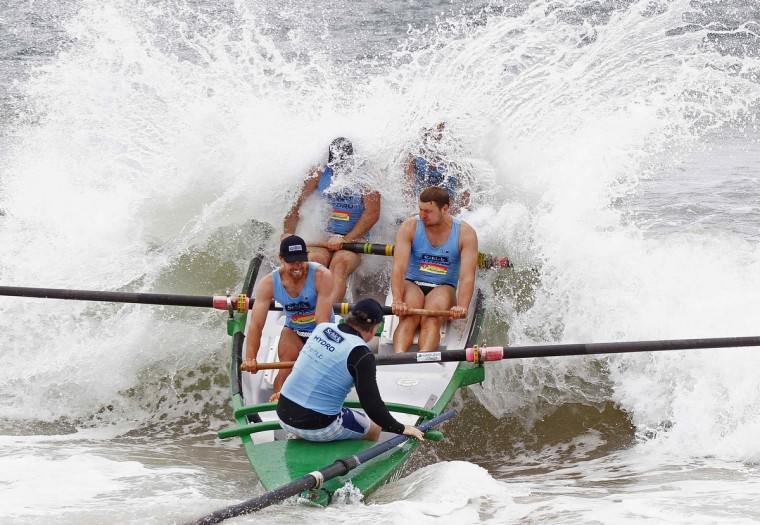 Crew members of Mona Vale surf club break a wave as they compete during their heat at the Ocean Thunder surf boat competition at Dee Why beach in Sydney December 15, 2012. (Daniel Munoz/Reuters)
