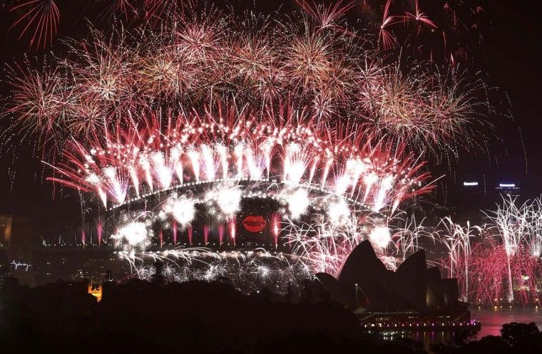 Fireworks explode over and around the Sydney Harbour Bridge and Sydney Opera House during new year celebrations January 1, 2013. More than 1.5 million people were expected to line the foreshores of the harbour to watch the annual new year fireworks show. (David Gray/Reuters)