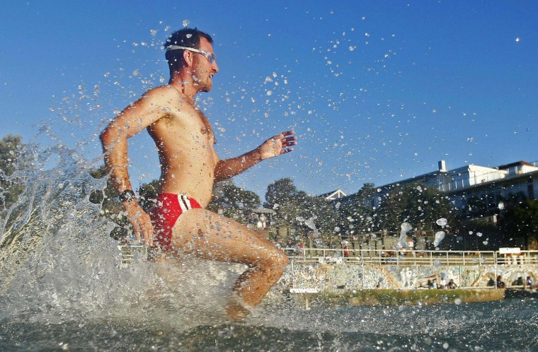 A man runs to the sea for an afternoon swim at Bondi Beach in Sydney. Australia's iconic Bondi beach receives up to 40,000 visitors on a busy summer day, according to local authorities. (Daniel Munoz/Reuters photo)