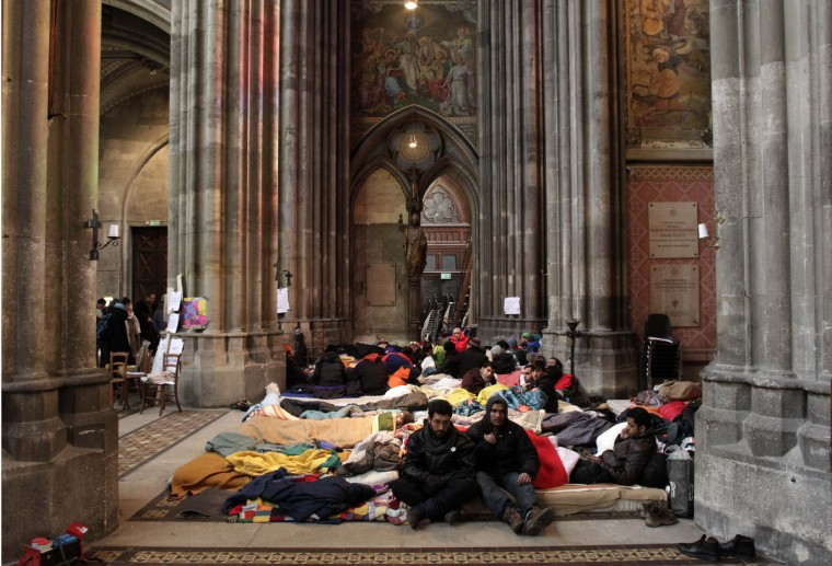 Refugees from Afghanistan and Pakistan take part in a hunger strike at Votivkirche church in Vienna. Some 30 refugees who are on hunger strike to protest for better conditions for asylum seekers in Austria, have been allowed to stay in the catholic church for the duration of their demonstration. A protest camp outside the church was cleared by police earlier on Friday. (Herwig Prammer/Reuters)
