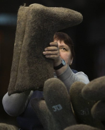 A worker sorts semi-finished valenki, traditional footwear made of raw wool, at a factory in the village of Smilovichi, some 35 km (22 miles) east of Minsk. Valenki, specifically designed for extreme frost typical of severe winter, remain popular in rural areas. The factory, established in 1928, produces 17,000 pairs of boots a month, according to its director. (Vasily Fedosenko/Reuters)