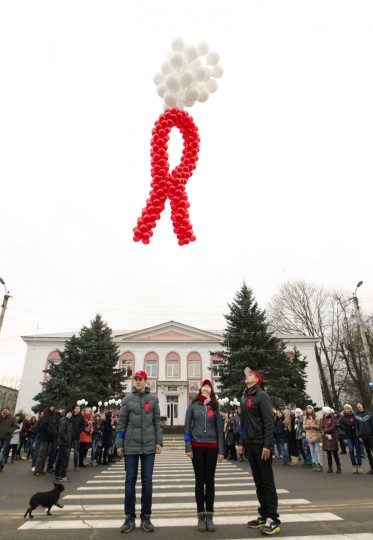 Belarusian youths release balloons, which form the shape of the AIDS awareness ribbon, as they take part in an AIDS awareness campaign to mark World AIDS Day in the town of Smolevichi, some 25 miles east of Minsk. (Vasily Fedosenko/Reuters)