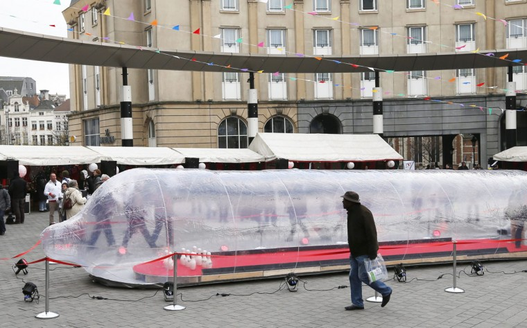 A man walks past a giant condom during an an event marking World AIDS Day in central Brussels, the capital of Belgium. (Francois Lenoir/Reuters)