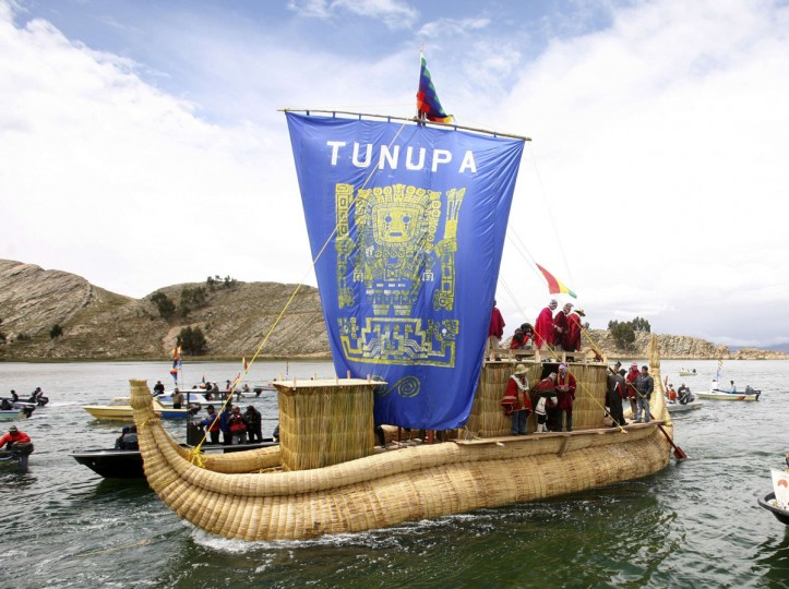 Mayan priests make offerings on the Tunupa ship in Lake Titicaca, 46 miles away from the Bolivian capital of La Paz, on December 16, 2012. The offerings took place on the first of six days of celebrations to commemorate the end of the Mayan Calendar on December 21, which some believe to be the end of the world, but which indigenous Bolivians regard as the change of an era. (Gaston Brito/Reuters)