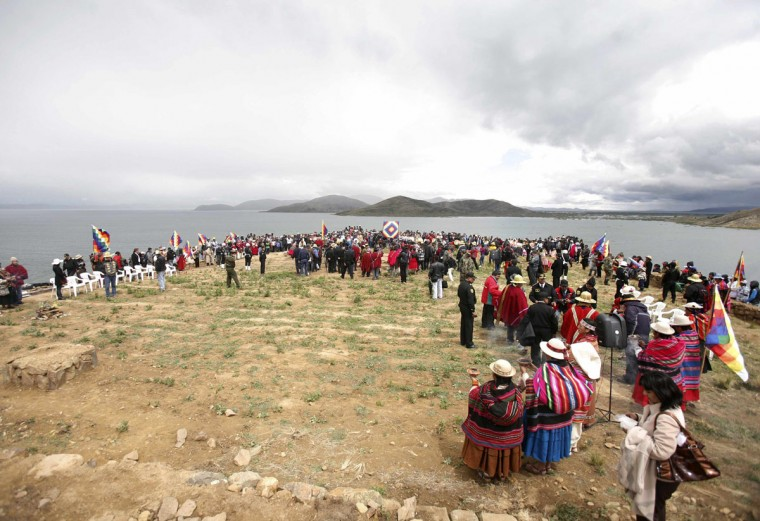 Indigenous Bolivians and Maya descendants take part in a ceremony of the sacred fire at Intja island near La Paz on December, 16 2012. The ceremony took place on the first of six days of celebrations to commemorate the end of the Mayan Calendar on December 21, which some believe to be the end of the world, but which indigenous Bolivians regard as the change of an era. (Gaston Brito/Reuters)