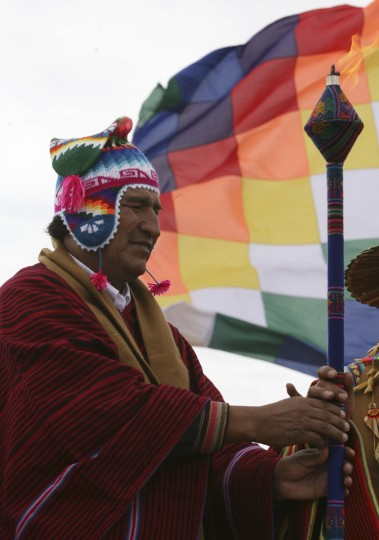 Bolivian President Evo Morales receives the sacred fire during a ceremony at Intja island, 46 miles away from Bolivia's capital city of La Paz, on December 16, 2012. The ceremony took place on the first of six days of celebrations to commemorate the end of the Mayan Calendar on December 21, which some believe to be the end of the world, but which indigenous Bolivians regard as the change of an era. (Gaston Brito/Reuters)