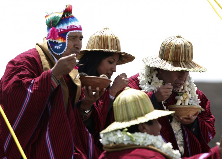 Bolivian President Evo Morales (left) and foreign ministerr David Choquehuanca eat a bowl of fish soup at the Tunupa ship in Lake Titicaca on December 16, 2012. The day was the first of six days of celebration to commemorate the end of the Mayan Calendar on December 21, which some believe to be the end of the world, but which indigenous Bolivians regard as the change of an era. (Gaston Brito/Reuters)