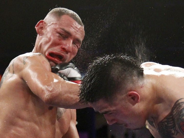 Brandon Rios (R) of the U.S. connects to the face with a punch on compatriot Mike Alvarado during the sixth round of their WBO Latino Super Lightweight Title boxing match in Carson, California October 13, 2012. Rios won by TKO in the seventh round. (Danny Moloshok/Reuters)