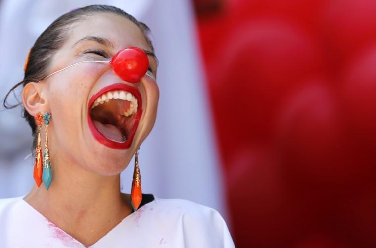 A reveler performs during a clown parade in Rio de Janeiro. The clown parade is part of a week-long international clown festival taking place in Rio de Janeiro between 3-9 December. (Sergio Moraes/Reuters)