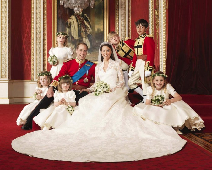 Britain's Prince William and his bride Catherine, Duchess of Cambridge, are seen posing for an official photograph, with their bridesmaids and pageboys, on the day of their wedding, in the throne room at Buckingham Palace, in central London in an April 29, 2011 file photograph. Britain's Prince William and his wife Catherine are expecting a baby, the prince's office said on December 3, 2012. (Hugo Burnand/Clarence House/Handout/Reuters Files)