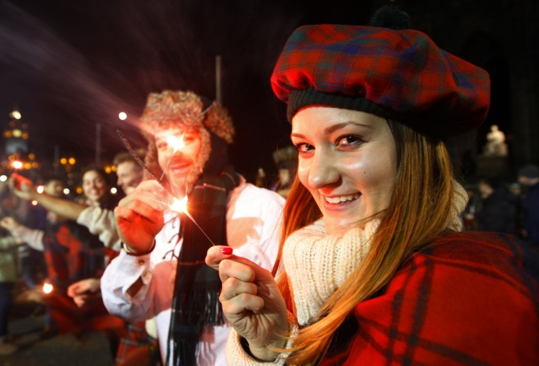 Nadine Rober from Vienna, holds a sparkler during the Hogmanay (New Year) street party celebrations in Edinburgh, Scotland December 31, 2012. (David Moir/Reuters)