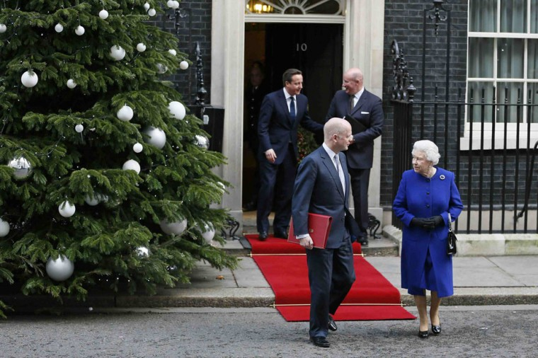Britain's Queen Elizabeth walks with Foreign Secretary William Hague, as she leaves after attending a cabinet meeting at Number 10 Downing Street in London. The Queen attended cabinet on Tuesday to mark her Diamond Jubilee, the first monarch to do so since Queen Victoria. (Stefan Wermuth/Reuters)