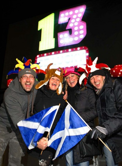 Revellers pose for photographers during the Hogmanay (New Year) street party celebrations in Edinburgh, Scotland December 31, 2012. (David Moir/Reuters)
