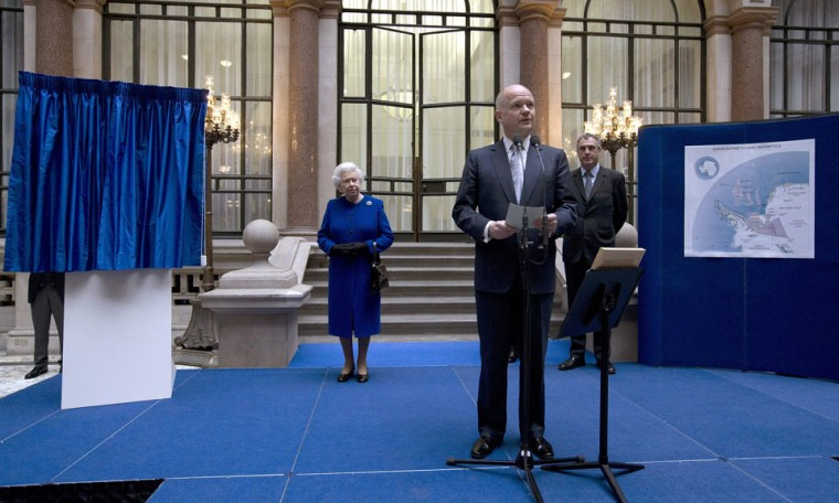 Britain's Queen Elizabeth listens to Foreign Secretary William Hague announce that a 169,000-square mile (437,000-square kilometre) section of the British Antarctic Territory has been renamed Queen Elizabeth Land, to mark the Queen's Diamond Jubilee, at the Foreign and Commonwealth Office in London. (Alastair Grant/Reuters)