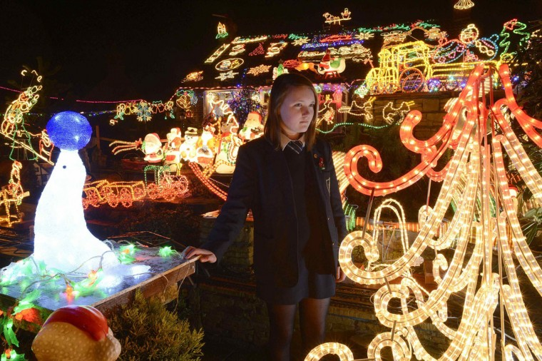 A girl looks at Christmas lights and figures on a house in Bagby in northern England. Homeowner Eric Marshall spends three weeks each year setting up the display, which runs throughout December to the Twelfth Night and raises funds for the local church. Marshall has raised nearly 20,000 British pounds over the past 20 years. He started with one Santa and sleigh. (Nigel Roddis/Reuters)