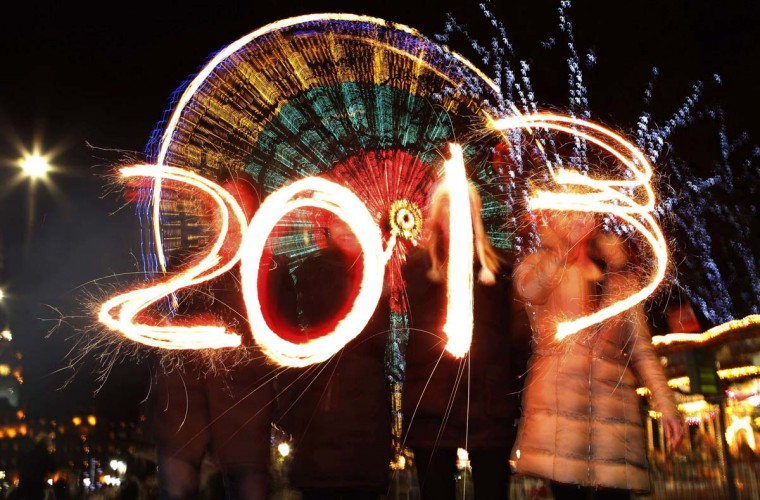 Revellers write the number 2013 using sparklers during the Hogmanay (New Year) street party celebrations in Edinburgh, Scotland December 31, 2012. (David Moir/Reuters)