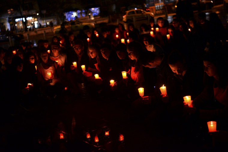 People hold lit candles during a ceremony to mark World AIDS day in Sofia, the capital of Bulgaria. (Tsvetelina Belutova/Reuters)
