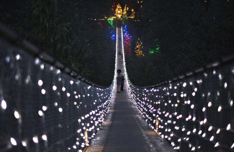 Visitors walk across the Capilano Suspension Bridge, decorated in lights for the holidays, in North Vancouver, British Columbia, Canada. Originally built in 1889, the bridge stretches 135 meters across and is situated 70 meters above the Capilano River. (Andy Clark/Reuters)