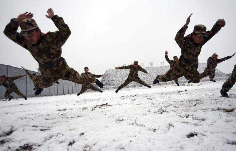 Paramilitary policemen practice during their winter training against extreme weather, in Nanjing, Jiangsu province December 26, 2012. (China Daily via Reuters)