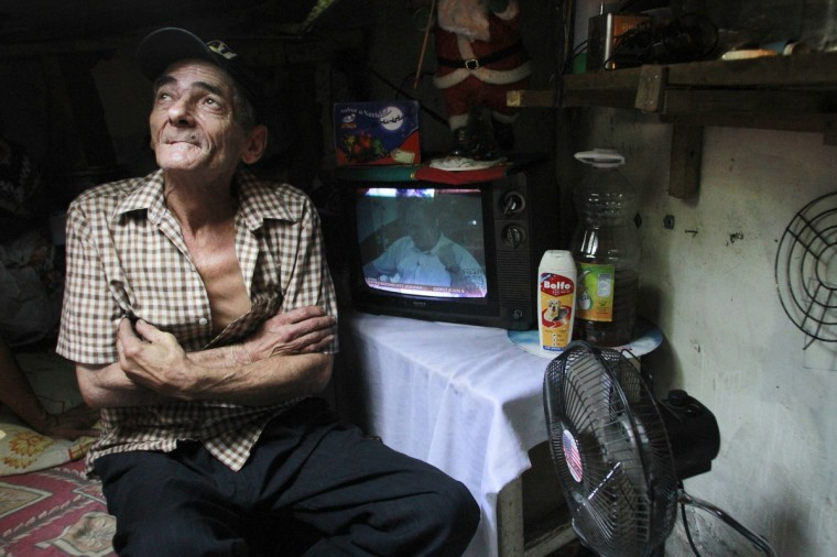 Miguel Restrepo, 62, looks up from his sewer home in Medellin. (Albeiro Lopera/Reuters)