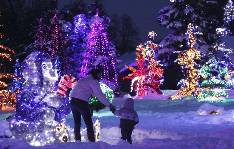 A mother and child look at a decorative bear at a country house estate in the village of Grabovnica near Cazma, central Croatia. The 17.3-acre estate owned by the Salaj family is lit with 1.3 million Christmas lights and turns into a winter wonderland every December, attracting thousands of visitors. (Antonio Bronic/Reuters)